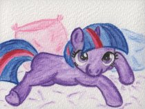 Filly Twilight lying on a blanket with cushions behind her